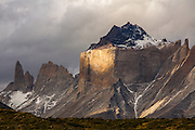 Last light shines through the clouds and onto Paine Grande in Torres del Paine National Park, Patagonia, Chile.