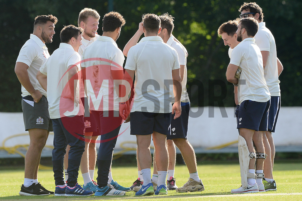 Bristol Rugby players gather around during an exhibition cricket game against Bishopston Cricket Club - Photo mandatory by-line: Dougie Allward/JMP - Mobile: 07966 386802 - 29/07/2015 - SPORT - Cricket - Bristol - Westbury Fields - Bishopston CC v Bristol Rugby - Exhibition Game