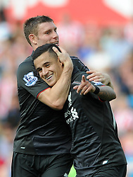 Philippe Coutinho of Liverpool celebrates with James Milner of Liverpool - Mandatory byline: Dougie Allward/JMP - 07966386802 - 09/08/2015 - FOOTBALL - Britannia Stadium -Stoke-On-Trent,England - Stoke City v Liverpool - Barclays Premier League