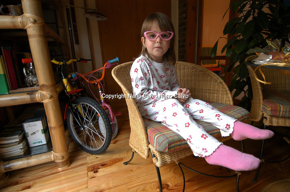 Cute three year old girl wearing her pijama and pink false glasses