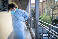 Milan - Coronavirus emergency. USCA Special Continuity Care Units. Dr. Lops visits a quarantined patient at home for being in contact with a positive. Before each contact, the doctor wears protective equipment