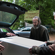 Life in the Save Leith Hill camp in Coldharbour Lane. Delivery of a freezer donated by a nearby local. Europa Oil and Gas company has got license to drill for oil in the woods near Leith Hill.  Proetctors of the land, a group of local campaigners against the proposed drilling and activists have set up a community camp on Coldharbour Lane to  protect Leith Hill from the unconventional oil exploration, through monitoring, awareness raising, and peaceful community action.