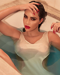 """Kim Kardashian releases a photo on Twitter with the following caption: """"""""Classic Red Lip 💋 Dropping online Jan 25 https://t.co/PoBZ3bhjs8"""""""". Photo Credit: Twitter *** No USA Distribution *** For Editorial Use Only *** Not to be Published in Books or Photo Books ***  Please note: Fees charged by the agency are for the agency's services only, and do not, nor are they intended to, convey to the user any ownership of Copyright or License in the material. The agency does not claim any ownership including but not limited to Copyright or License in the attached material. By publishing this material you expressly agree to indemnify and to hold the agency and its directors, shareholders and employees harmless from any loss, claims, damages, demands, expenses (including legal fees), or any causes of action or allegation against the agency arising out of or connected in any way with publication of the material."""