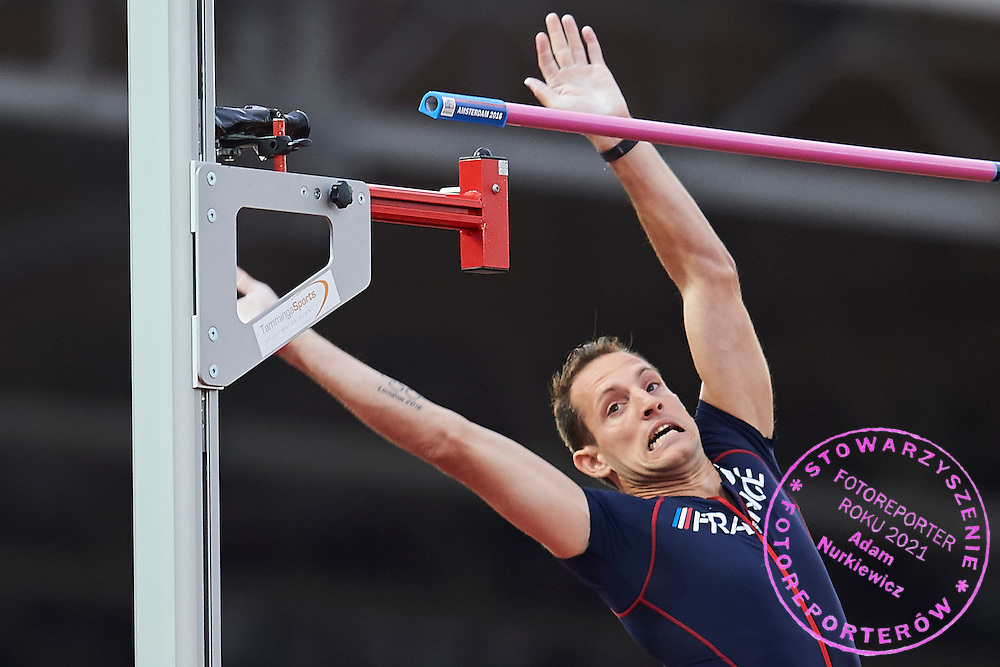 Amsterdam, Netherlands - 2016 July 08: Renaud Lavillenie from France failed his attempt in men&rsquo;s pole vault reacts after failed competition during European Championships Athletics 2016 at Olympic Stadium on July 08, 2016 in Amsterdam, Netherlands.<br /> <br /> Adam Nurkiewicz declares that he has no rights to the image of people at the photographs of his authorship.<br /> <br /> Picture also available in RAW (NEF) or TIFF format on special request.<br /> <br /> Any editorial, commercial or promotional use requires written permission from the author of image.<br /> <br /> Mandatory credit:<br /> Photo by &copy; Adam Nurkiewicz