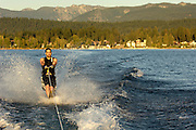 USA. Idaho, Man water skiing on Payette Lake with McCall in background. MR