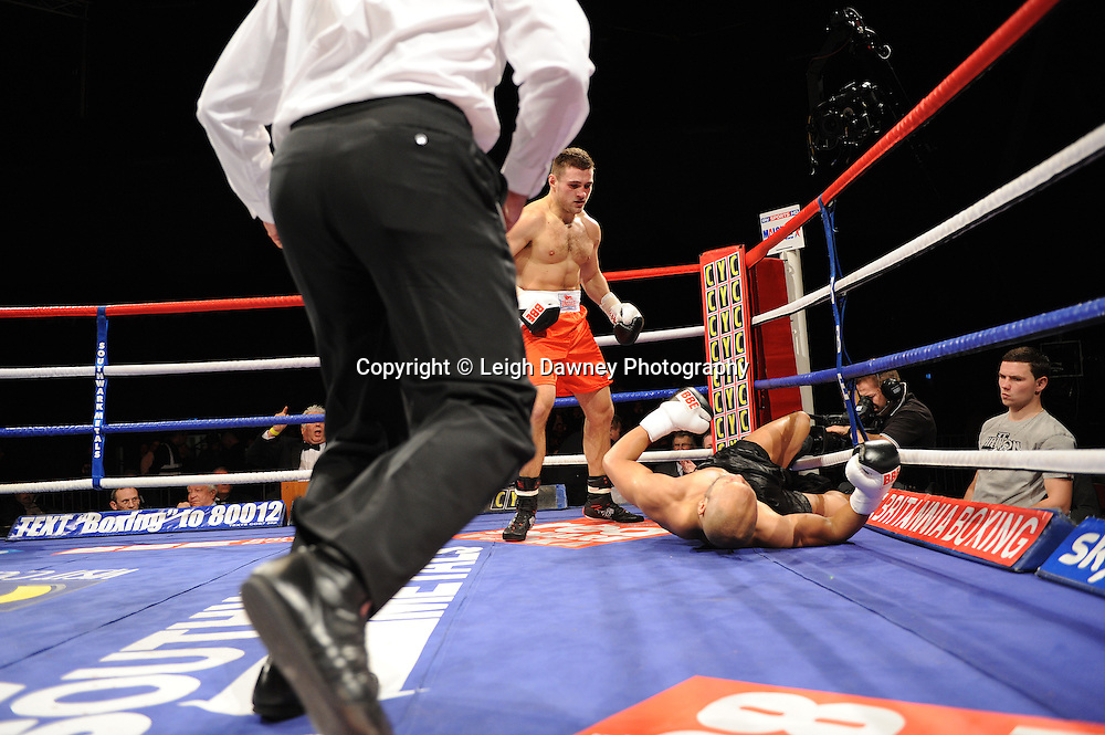 Richard Turba (red shorts) defeats Leon Williams at Brentwood Centre, Brentwood, Essex on the 5th February 2011. Frank Maloney Promotions. Photo credit © Leigh Dawney