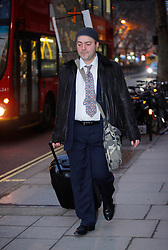 © under license to London News Pictures. 02/02/11 Konstantinos Kalomoiris, former John Lewis shop assistant, leaves Central London employment tribunal. He is claiming sex discrimination after a 68-year-old female colleague allegedly slapped his bottom three times while working at the John Lewis Oxford Street store. Photo credit should read: Olivia Harris/ London News Pictures