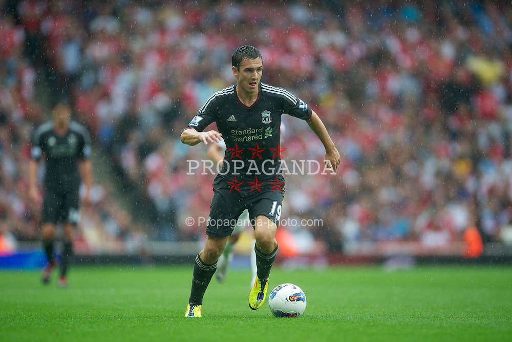 LONDON, ENGLAND - Saturday, August 20, 2011: Liverpool's Stewart Downing in action against Arsenal during the Premiership match at the Emirates Stadium. (Pic by David Rawcliffe/Propaganda)