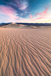 """Sunset at Ibex Dunes 2"" - Colorful sunset photograph of ripples in the sand at the Ibex Sand Dunes in Death Valley, California."