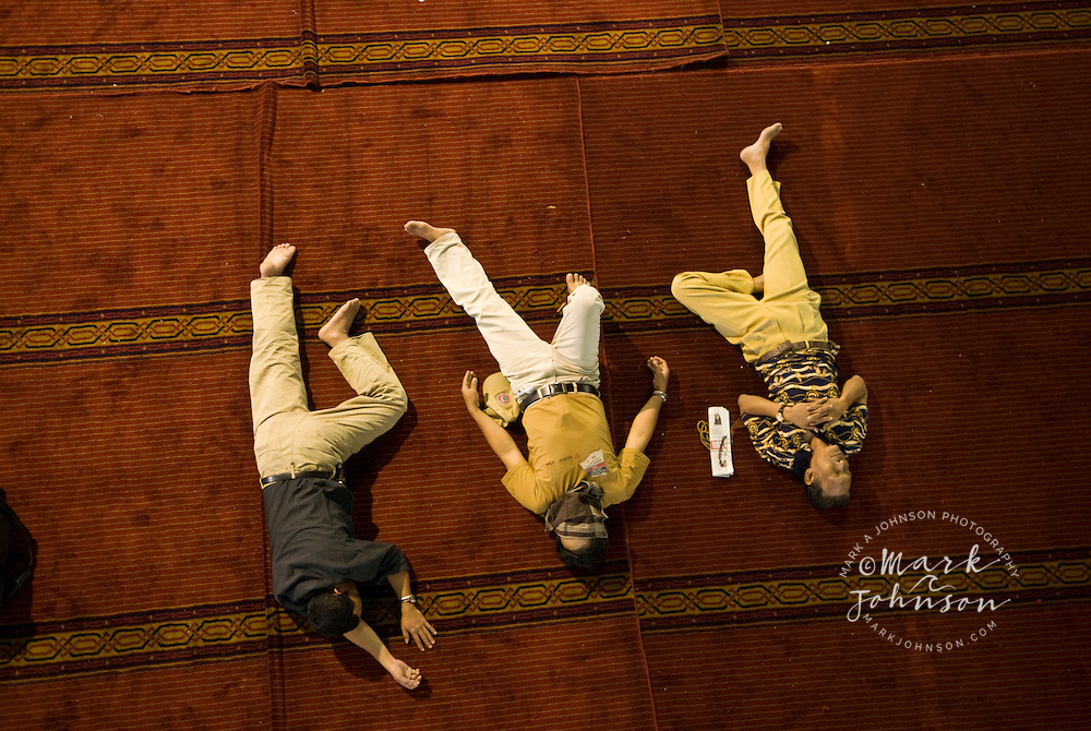 Men napping on the floor of the Istiqlal Mosque, Jakarta, Indonesia