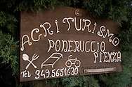 A carved wooden sign for 'Agriturismo', farmhouse accomodation near Pienza, Val d'Orcia, Tuscany, Italy