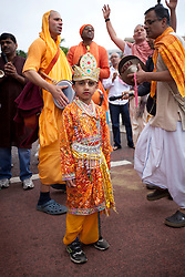 © Licensed to London News Pictures. 09/06/2013. London, UK. A young member of the Hare Krishna movement is seen amongst dancers in Hyde Park, London, today (09/06/2013) during the Hare Krishna festival of 'Rathayatra'. The parade, also known as the 'Festival of Chariots', is the biggest street festival celebrated by members of the Krishna followers and, in London, features three huge, wooden chariots containing the smiling figures of Lord Jagannatha, Lady Subhadra and Lord Balarama being pulled by hand from Hyde Park to Trafalgar Square.  Photo credit: Matt Cetti-Roberts/LNP