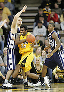 24 JANUARY 2007: Iowa forward Tyler Smith (34) tries to get around Penn State forward Milos Bogetic (41) in Iowa's 79-63 win over Penn State at Carver-Hawkeye Arena in Iowa City, Iowa on January 24, 2007.
