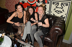Left to right, AMANDA FERRY, KATE WINSER and ASTRID HARBORD at the opening party of MODE nightclub, 12 Acklam Road, London on 4th April 2014.