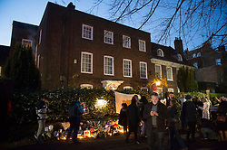 Mourners gather at George Michael's house in Highgate, North London, UK, to lay flowers and pay their respects following the singer's death.