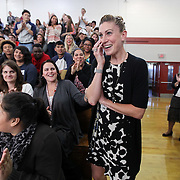 Surrounded by students and fellow faculty members, Lauren Jensen, an English teacher at Glen Cove High School, reacts as she is announced as the winner of the unrestricted $25,000 Milken Educator Award during a surprise assembly at the school in Glen Cove Wednesday, Nov. 4, 2015.
