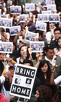 June 03, 2009; Santa Monica, CA - Supporters hold up signs and candles at a candlelight vigil at Wokcano for Euna Lee and Laura Ling, two American journalists who have been detained in North Korea for nearly three months...Photo Credit: Darrell Miho