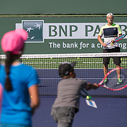 March 7, 2015, Indian Wells, California:<br /> Denis Kudla plays with kids on court during Kids Day at the Indian Wells Tennis Garden in Indian Wells, California Saturday, March 7, 2015.<br /> (Photo by Billie Weiss/BNP Paribas Open)