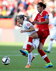 12.06.2015, Commonwealth Stadium, Edmonton, CAN, FIFA WM, Frauen, Kanada vs Neuseeland, Gruppe A, im Bild Christine Sinclair (R)of Canada vies with Katie Duncan of New Zealand. The match ended with a 0-0 dra // during group A match of FIFA Women's World Cup between Canada and New Zealand at the Commonwealth Stadium in Edmonton, Canada on 2015/06/12. EXPA Pictures © 2015, PhotoCredit: EXPA/ Photoshot/ Wang Lili<br /> <br /> *****ATTENTION - for AUT, SLO, CRO, SRB, BIH, MAZ only*****