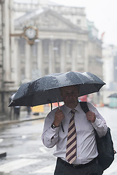© licensed to London News Pictures. London, UK 30/07/2013. People walking under the rain in City of London on Tuesday, July 30, 2013. Photo credit: Tolga Akmen/LNP