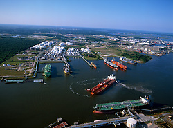 Aerial view of tugboats turning a tanker in the Port of Houston