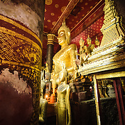 The altar at Wat Mai Suwannaphumaham.  Wat Mai, as it is often known, is a Buddhist temple in Luang Prabang, Laos, located near the Royal Palace Museum. It was built in the 18th century and is one of the most richly decorated Wats in Luang Prabang.