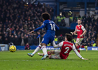 Football - 2019 / 2020 Premier League - Chelsea vs. Arsenal<br /> <br /> Hector Bellerin (Arsenal FC) with a well timed tackle to take the ball away from Willian (Chelsea FC) at Stamford Bridge <br /> <br /> COLORSPORT/DANIEL BEARHAM
