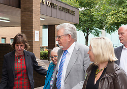 London, June 26th 2014. Entertainer and artist Rolf Harris leaves Southwark Crown Court with his niece, left, his wife Alwen and his daughter Bindi, right, after a sixth day of waiting for the jury's verdict on the 12 counts of indecent assault against 4 girls aged 7- 16 that he faces.