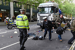 © Licensed to London News Pictures. 03/05/2017. London, UK. Police and emergency services attend the scene of a reported traffic accident between a lorry and a motorbike which has taken place in Northumberland Avenue near Trafalgar Square.  The injured motorcyclist has been taken to hospital via an air ambulance and the road is currently cordoned off.   Photo credit : Stephen Chung/LNP