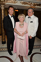 Left to right, SIR CLIFF RICHARD, GLORIA HUNNIFORD and STEPHEN WAY at the annual PINKTOBER Gala presented by Hard Rock Heals at The Dorchester, Park Lane, London on 14th October 2016.  The annual event raises money for The Caron Keating Foundation.