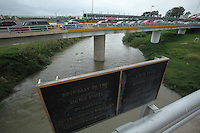 A sign marks the border between the US and Mexico on the Gateway Bridge, which connects Brownsville, TX to Matamoros, Mexico, seen from the side of Brownsville, TX on April 22, 2010. (Photo/Scott Dalton)