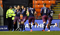 Arsenal's Joe Willock (left) celebrates scoring his side's first goal of the game during the Emirates FA Cup, third round match at Bloomfield Road, Blackpool.