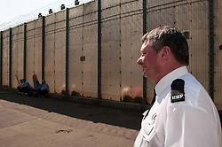 Prison officer outside a cell block, HMP Barlinnie, Glasgow
