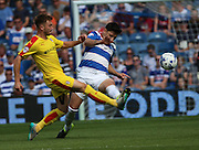 Lee Frecklington (Rotherham midfielder) on the receiving end of as robust challenge from Alejandro Faurlin (QPR midfielder) during the Sky Bet Championship match between Queens Park Rangers and Rotherham United at the Loftus Road Stadium, London, England on 22 August 2015. Photo by Matthew Redman.
