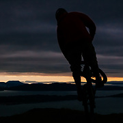 Owen Dudley exits the forest for the sea on a coastal mountain bike trail near Bellingham Washington.