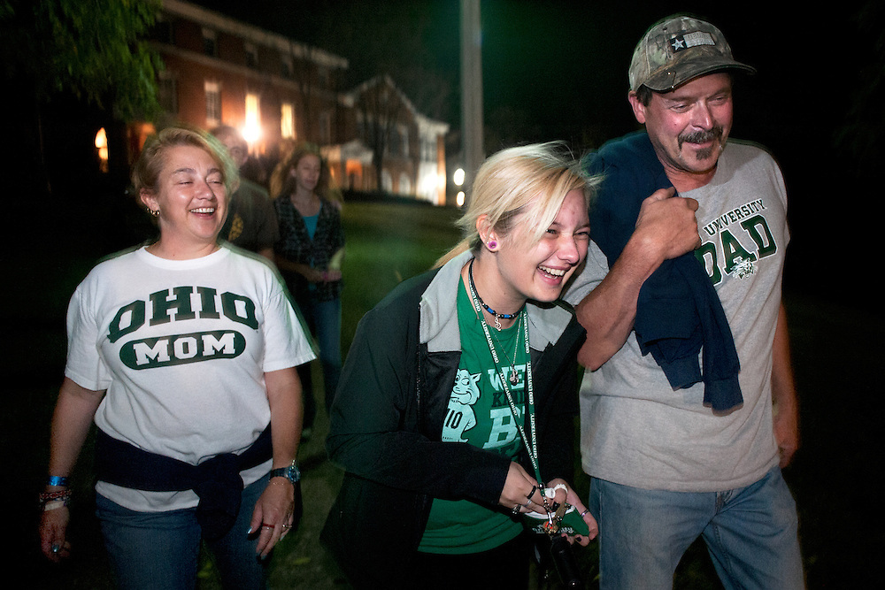 Christel Meeks (left), her daughter Gabby Meeks (center) and her husdand Bill Meeks (right) share a joke during a parents weekend  walk hosted by Outdoor Pursuits. Students and parents walked on the ridges nature trail and took a tour of the grounds before stopping at the ropes course for a campfire and smores. Gabby Meeks is an Ohio University freshman studying Marine Biology. Photo by: Ross Brinkerhoff.