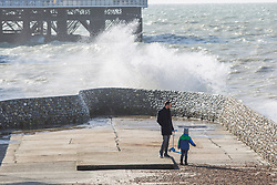 © Licensed to London News Pictures. 22/10/2017. Brighton, UK. Members of the brighton Swimming Club brave the powerful waves to go for a Sunday morning swim in the sea of Brighton and Hove. Photo credit: Hugo Michiels/LNP