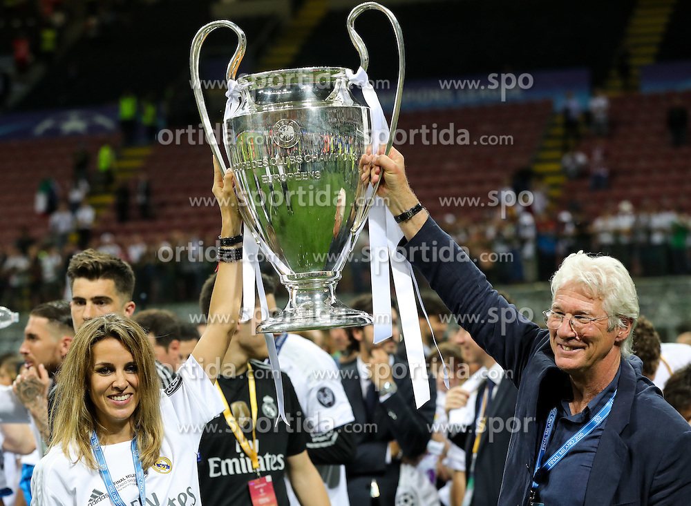 Alejandra Silva and actor Richard Gere celebrate with the Trophy of Real Madrid after team won during football match between Real Madrid (ESP) and Atlético de Madrid (ESP) in Final of UEFA Champions League 2016, on May 28, 2016 in San Siro Stadium, Milan, Italy. Photo by Vid Ponikvar / Sportida