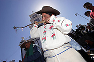 """Bolivia.Tarija. San Roque. The """"Caña"""" is a traditional folk instrument of the city, almost three meters long sounds like a trombone and playing with the principle of the trumpet, he starts playing with the feast of St. Roque, accompaning all the processions."""