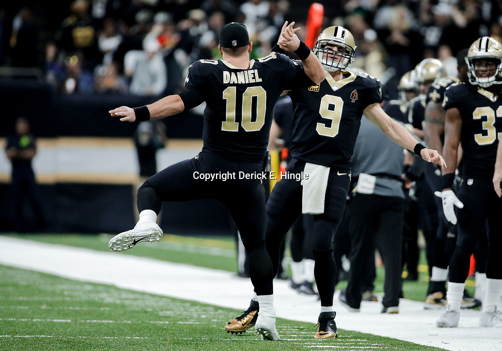 Dec 24, 2017; New Orleans, LA, USA; New Orleans Saints quarterback Drew Brees (9) celebrates with quarterback Chase Daniel (10) after throwing a touchdown to wide receiver Ted Ginn (not pictured) during the second quarter against the Atlanta Falcons at the Mercedes-Benz Superdome. Mandatory Credit: Derick E. Hingle-USA TODAY Sports