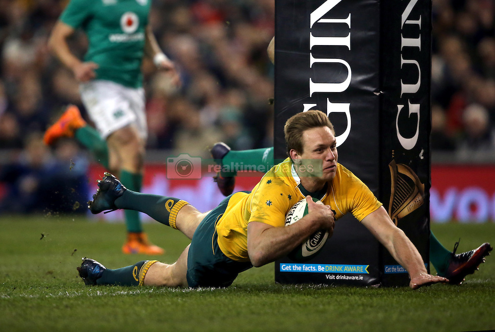 Australia's Dane Haylett-Petty scores his side's first try during the Autumn International match at the Aviva Stadium, Dublin.