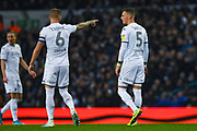 Leeds United defender Ben White (5) and Leeds United defender Liam Cooper (6) during the EFL Sky Bet Championship match between Leeds United and Queens Park Rangers at Elland Road, Leeds, England on 2 November 2019.