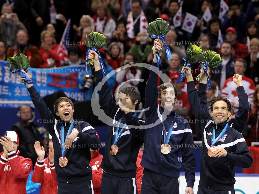 26 February 2010: J.R. CELSKI from USA #252, Travis JAYNER from USA #254, Jordan MALONE from USA #255, Apolo Anton OHNO from USA #256 The USA team Celebrates finishing third winning the bronze medal  at the end of the men's 5000m Team Relay in short track speed skating held at the Pacific Coliseum during the Vancouver 2010 Winter Olympics  in Vancouver,  British Columbia, Canada..