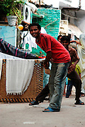 Kids playing cricket in the streets of Paragang, Delhi, India