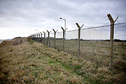 © Licensed to London News Pictures. 22/10/2017. Bawdsey, UK.  Fencing surrounding the base. RAF Bawdsey, WW2 radar and Cold-War Bloodhound Surface to Air Missile (SAM) base at Bawdsey Ferry, Suffolk, today 22nd October 2017. The base was decommissioned in 1991 leaving behind a deserted base.  Photo credit: Stephen Simpson/LNP