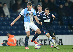 Blackburn Rovers's Tommy Spurr competes with Bolton Wanderers' Adam Le Fondre - Photo mandatory by-line: Richard Martin-Roberts/JMP - Mobile: 07966 386802 - 11/03/2015 - SPORT - Football - Blackburn - Ewood Park - Blackburn Rovers v Bolton Wanderers - Sky Bet Championship