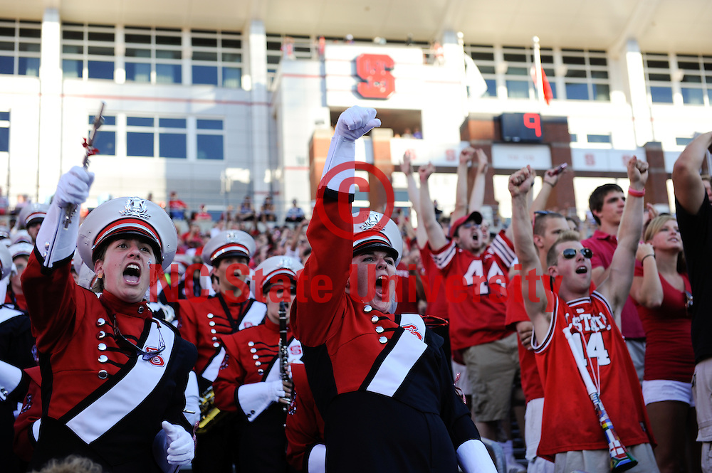 Members of the band cheer on the Pack during their football game against Western Carolina at Carter Finley. Photo by Marc Hall