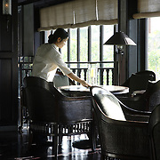 A waitress sets a table at the Nam Hai luxury resort in Danang, Vietnam.