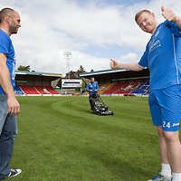 FOR SUNDAY PAPERS ONLY....<br /> St Johnstone's Alan Mannus and Brian Easton interupted by ground staff Jordan Thomson cutting the pitch at McDiarmid Park ahead of the William Hill Scottish Cup Final against Dundee United on the 17th May 2014.<br /> Picture by Graeme Hart.<br /> Copyright Perthshire Picture Agency<br /> Tel: 01738 623350  Mobile: 07990 594431