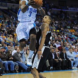 Jan 18, 2010; New Orleans, LA, USA; New Orleans Hornets guard Chris Paul (3) drives past San Antonio Spurs guard George Hill (3) during the second half at the New Orleans Arena. The Spurs defeated the Hornets 97-90. Mandatory Credit: Derick E. Hingle-US PRESSWIRE